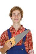 Carpenter with handsaw Stock Photos