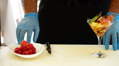Professional chef hands decorating a cocktail Stock Footage