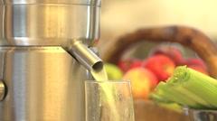 Juicing juicer squirting green juice - stock footage