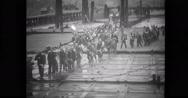 Chinese prisoners board landing craft Stock Footage