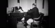 Ambassador Joseph P. Kennedy working in office Stock Footage