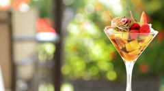 Cocktail glass with strawberry and mango Stock Footage