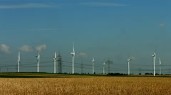 Wind energy generators and power lines Stock Footage