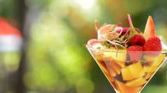 Cocktail glass with strawberry and mango short plane Stock Footage