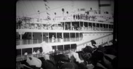 Crowd waving at passenger ship leaving harbour Stock Footage