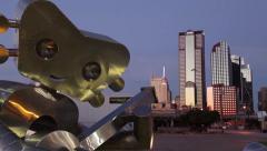 Dallas Skyline w/ public art GuitarMan sculpture time-lapse daybreak Stock Footage