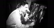 Airforce lieutenant sitting in front of radar scope unit and giving information Stock Footage