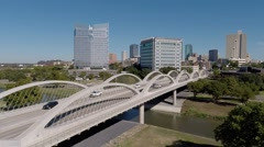 Fly over Fort Worth 7th Street bridge and Trinity River Bridge w/ skyline  Stock Footage