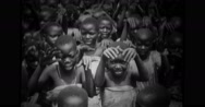 Native children of Uganda singing song, clapping and dancing Stock Footage