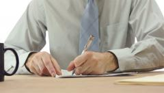 Office Worker Checks Off Paper List - stock footage
