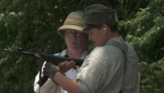 WW1 Father teaching Son machine gun 2 Stock Footage