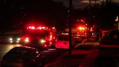 Emergency Ambulance on call to house at night, rack focus Stock Footage