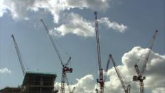 Stock Video Footage of Construction Cranes Tracking Shot