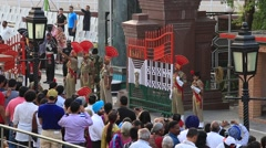 Indian guards at the Indian - Pakistan border during the border closing ceremony Stock Footage