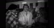 American housewife training Japanese brides to shop for fruits in store Stock Footage