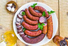 plate full various species sausages - stock photo