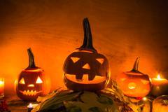 Halloween pumpkin lanterns dark light angry face fall Stock Photos