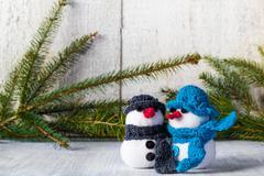 snowmen board wooden christmas winter plush duo - stock photo