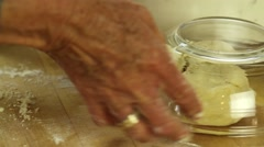 Woman forming pie crust dough Stock Footage