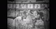 Civilians building house Stock Footage