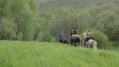 1800's Riding Away on Horseback Stock Footage