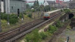 Berlin - August 22 - Train passing on railroads in Berlin - stock footage