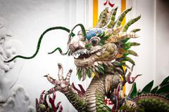 Dragon statue on white background, vietnam, asia. Stock Photos