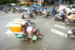 Stream of bikes in busy street in vietnam. Stock Photos