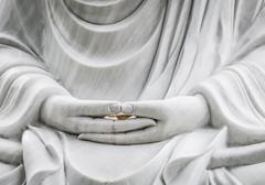 Buddha statue with hands as main subject. Stock Photos