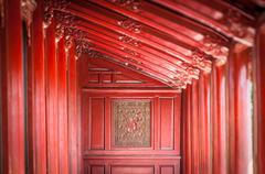 red wooden hall in citadel of hue, vietnam, asia. - stock photo