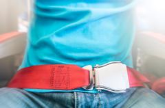 man wearing red seat belt. safety measures. - stock photo