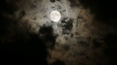Full Moon in night sky with clouds - stock footage