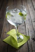 gin and tonic garnished with lime - stock photo