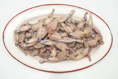 Fresh and raw frog legs ready to be cooked Stock Photos