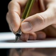 man writing with a fountain pen - stock photo