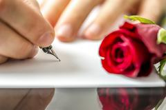 man writing a letter to his sweetheart - stock photo