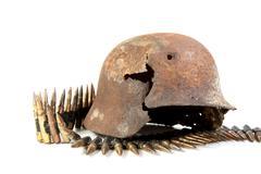 the rusty raked helmet and machine-gun tape - stock photo