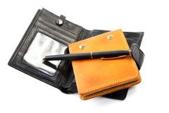purse and leather organizer with  pen on  white background - stock photo
