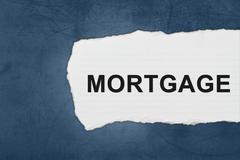 Stock Photo of mortgage with white paper tears
