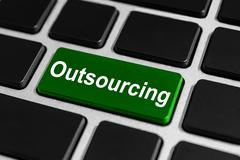 outsourcing button on keyboard - stock photo
