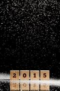 Falling snow on wooden cubes with 2015 text Kuvituskuvat