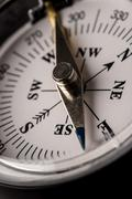 detail of a magnetic compass - stock photo