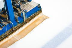 the machine for resurfacing ice in stadium - stock photo