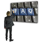 businessman activating a faq key - stock photo