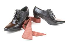 Pair of black female shoes and  leather belt isolated Stock Photos