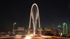 Dallas skyline Time-lapse night w/ Margaret Hunt Hill Bridge traffic streaking  Stock Footage