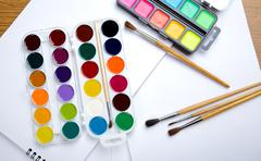 Water colour paints  brush albums for drawing Stock Photos
