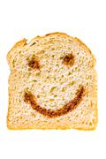 A slice of bread with nutella smile Stock Photos
