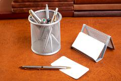 organizer support for papers and  pen on a textural - stock photo