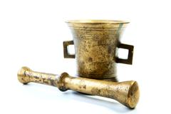 brass mortar with a pestle isolated on a white - stock photo